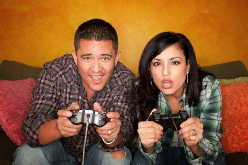 hispanic-couple-playing-video-game